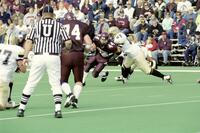 Augsburg men's football player about to be tackled by rival player, 2001