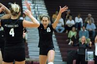 Two Augsburg women's volleyball players celebrating, circa 2005