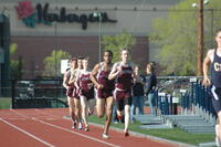 Augsburg men's track and field team runners running in a race, 2010.