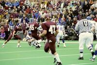 Augsburg men's football team plays a game as fans watch, 2001