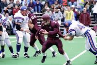 Augsburg men's football player holding ball runs away from rival player, 2001