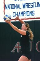 Augsburg women's volleyball player preparing to serve the ball, circa 2005