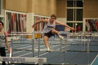 Augsburg men's track and field team runner doing hurdles, circa 2010
