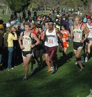 An Augsburg men's cross country team runner running in a race at the 2011 MIAC Championships, 2011.