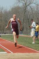 An Augsburg men's track and field team long jumper running in an event, 2009.