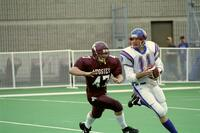 Augsburg men's football player runs after rival player holding the ball, 2001