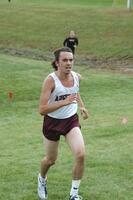 An Augsburg men's cross country team runner running in a race at a St. Olaf invite, 2010.