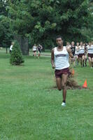 An Augsburg men's cross country team runner running in a race, 2011.