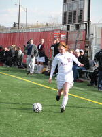Augsburg women's soccer player kicks the ball down the field, circa 2005