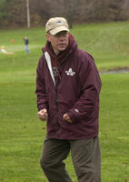 An Augsburg men's cross country team coach on the sidelines during a race, 2004.