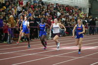 Augsburg women's track and field team runner during a race, circa 2010