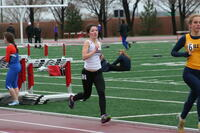 Augsburg women's track and field team runner running, circa 2010