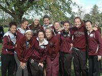 Augsburg women's cross country team runners take a group picture, 2011.