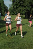 Augsburg women's cross country team runners running in a race, 2011.