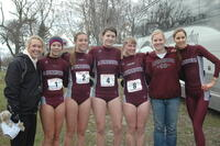 Augsburg women's cross country team runners take a group picture with their coaches, 2008.