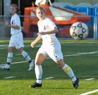 Augsburg women's soccer player kicking the ball, circa 2005