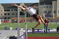 Augsburg men's track and field team player doing the high jump, circa 2010