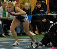 Augsburg women's track and field team runner taking off, circa 2005