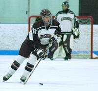 Augsburg women's hockey player dribbling the puck, circa 2005