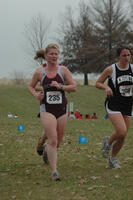 An Augsburg women's cross country runner in motion during a race at Grinnell College, 2001.