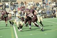 Augsburg men's football player runs with the ball past rival players, 2001