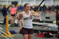Augsburg women's track and field team player preparing to do the pole vault, circa 2010