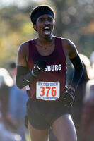An Augsburg men's cross country team runner running in a race at the 2013 MIAC Championships, 2013.