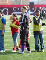 Augsburg women's soccer player helping out during a soccer clinic, circa 2005