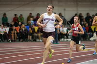 Augsburg women's track and field team runner running during a relay race, circa 2010