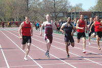 An Augsburg men's track and field team sprinter in a race, 2010.