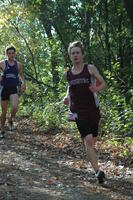 An Augsburg men's cross country team runner running in a race at Carleton College, 2008.