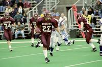 Augsburg men's football player runs with the ball, 2001