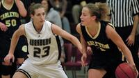 Augsburg women's basketball player guarding rival player, circa 2005
