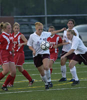 Augsburg women's soccer player about to kick the ball, circa 2005
