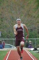 An Augsburg men's track and field team runner running in a long jump event, 2009.