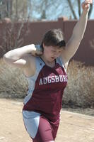 An Augsburg women's shot putter team member in action during an event, 2010.