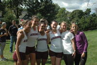 Augsburg women's cross country team runners take a group picture with their coach, 2010.