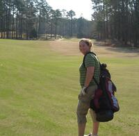 Augsburg women's golf team player on the course, circa 2005