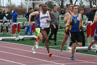 Augsburg men's track and field team runner running, circa 2010