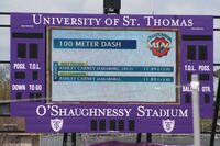 University of St. Thomas's scoreboard which lists Augsburg women's track and field team runner Ashley Carney as the 100 meter dash 2012 champion, 2012