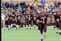 Augsburg men's football team runs onto the field, 2001