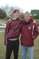 An Augsburg women's cross country team runner takes a picture with his coach, 2008.