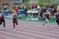 Augsburg women's track and field team runners running in a race, 2010.