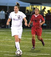 Augsburg women's soccer players during a game, circa 2005