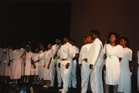 A Black choir singing in front of microphones, circa 1988