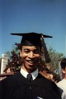A Black graduate smiling at the camera, 1989