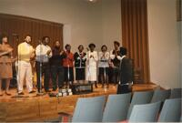 A Black choir performing on stage, circa 1988