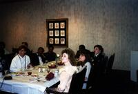 unidentified Black people and others sitting at a dinner table, circa 1988