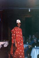 A Black person walks down the runway, 1990