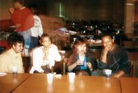 Black people are hanging out at a table in Christensen, 1990